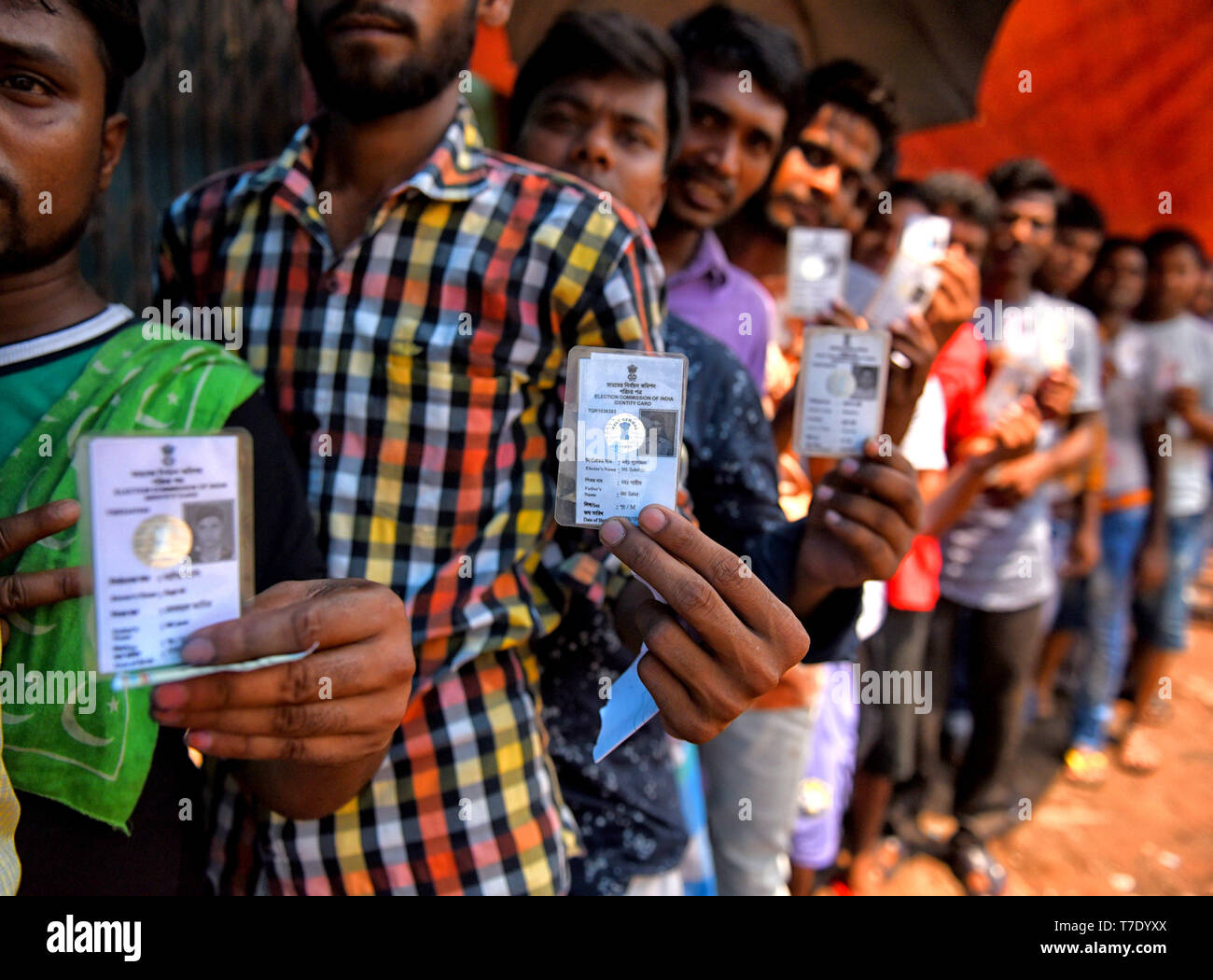 Voters seen with their Identity Cards before casting their Votes at a polling station during the 5th Phase of General Elections of India. - Stock Image