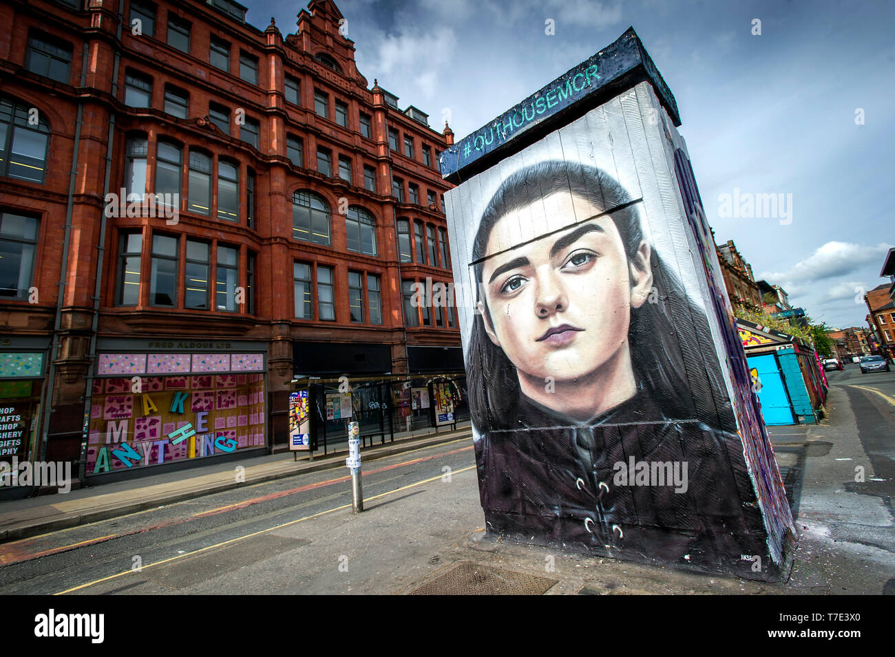 Manchester, UK. 7th May 2019. A new piece of street art has appeared in Stevenson Square in the Northern Quarter of Manchester, UK. The art work depicts the Game of Thrones character Arya Stark, played by actress Maisie Williams, and was created by artist Akse, the French-born street artist who has been living and working in Manchester since 1997. It's all part of outdoor public art project Outhouse MCR, which oversees the street art-rich part of the city centre. Credit: Paul Heyes/Alamy Live News - Stock Image