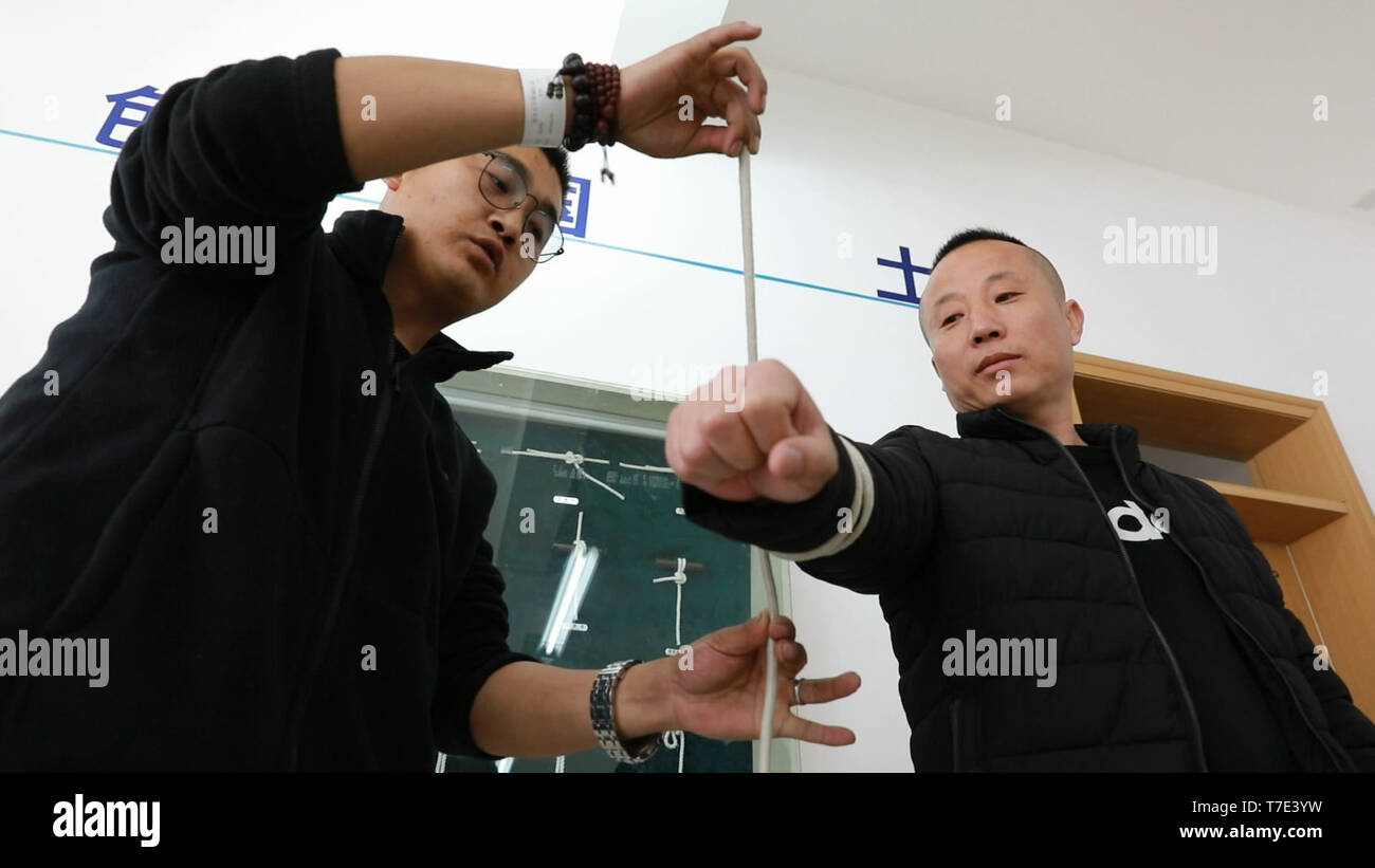 Beijing, China. 7th May, 2019. This video screenshot shows people receiving a four-month vocational training course as a sailor at the Yan'an Vocational and Technical College in Yan'an, northwest China's Shaanxi Province. Credit: Li Hua/Xinhua/Alamy Live News - Stock Image