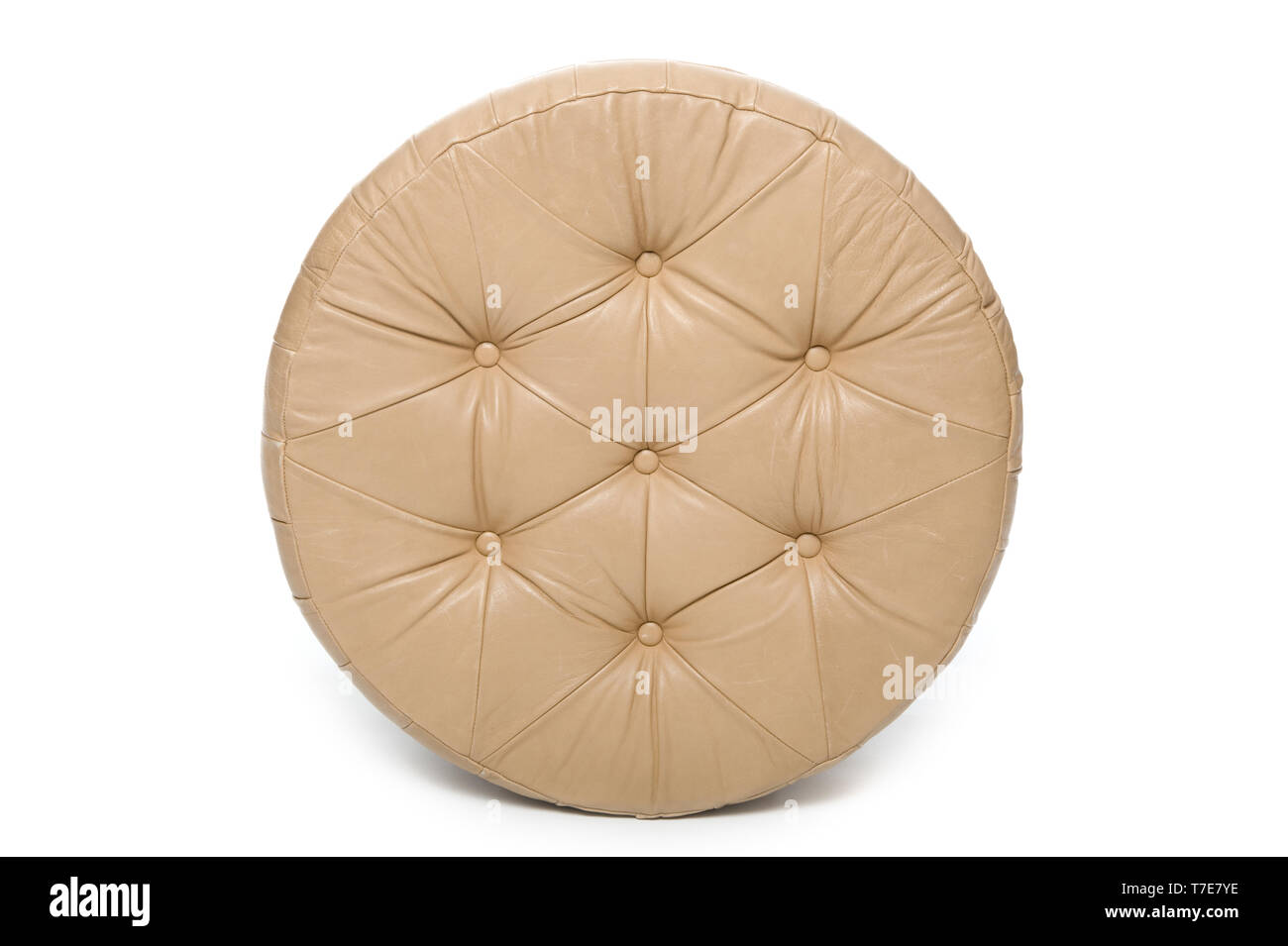 Leather floor stool on white background - Stock Image