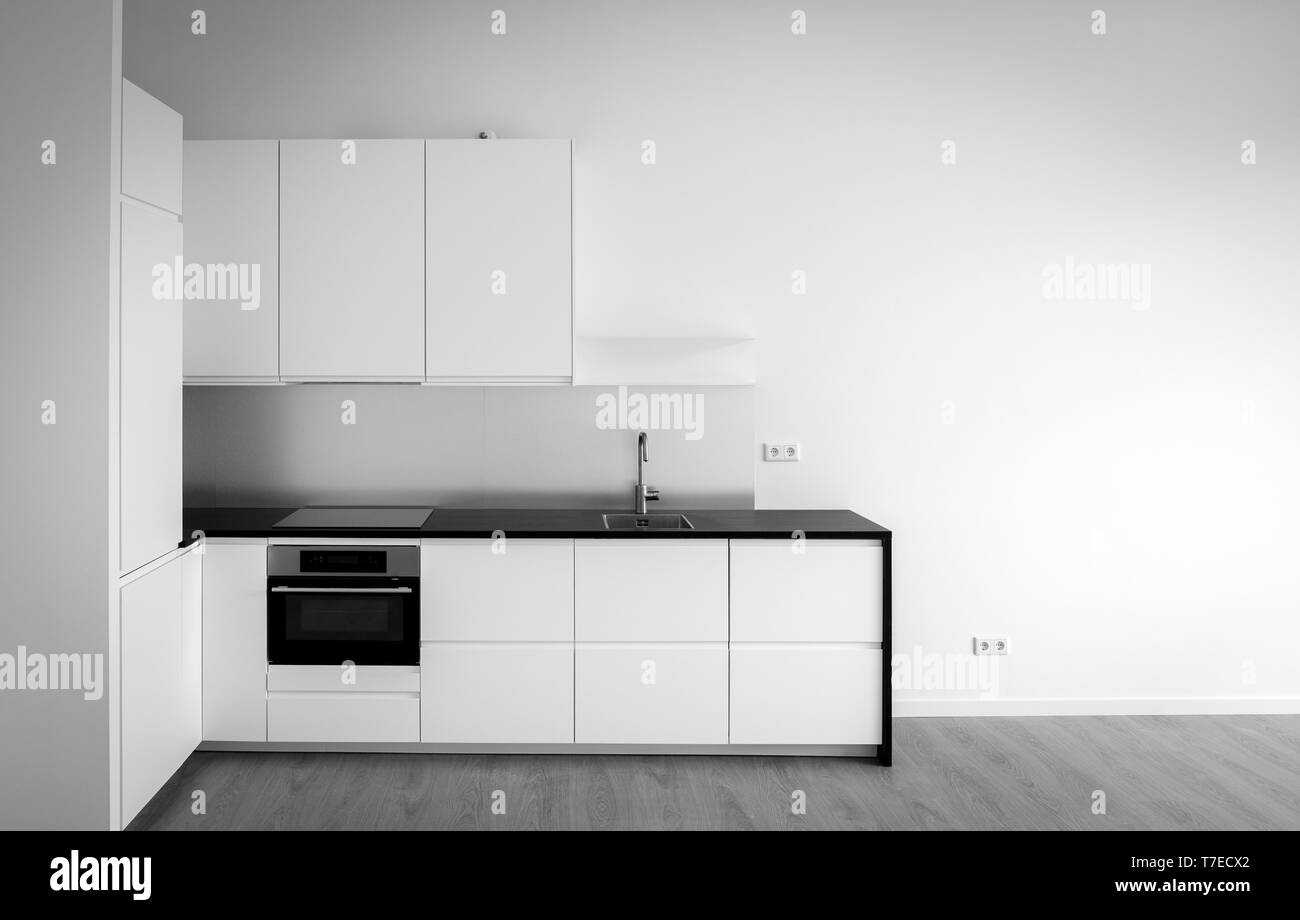 Newly built kitchen in empty living room for sale - Stock Image