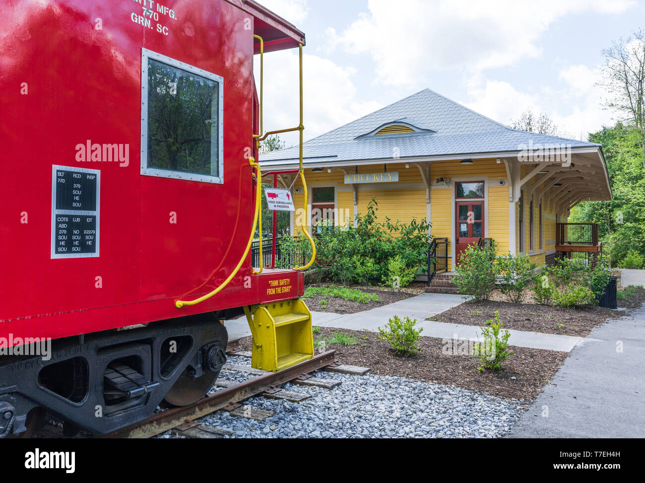 JONESBOROUGH, TN, USA-4/28/19: The museum in the old Chuckey train depot stands in Rowe Park, along with a red caboose. - Stock Image