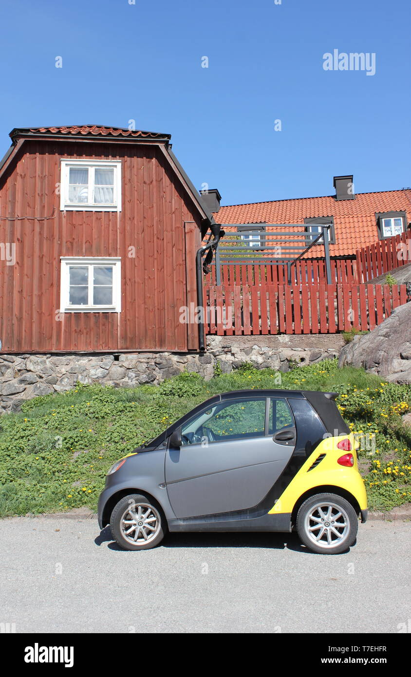 Small car on the old street - Stock Image