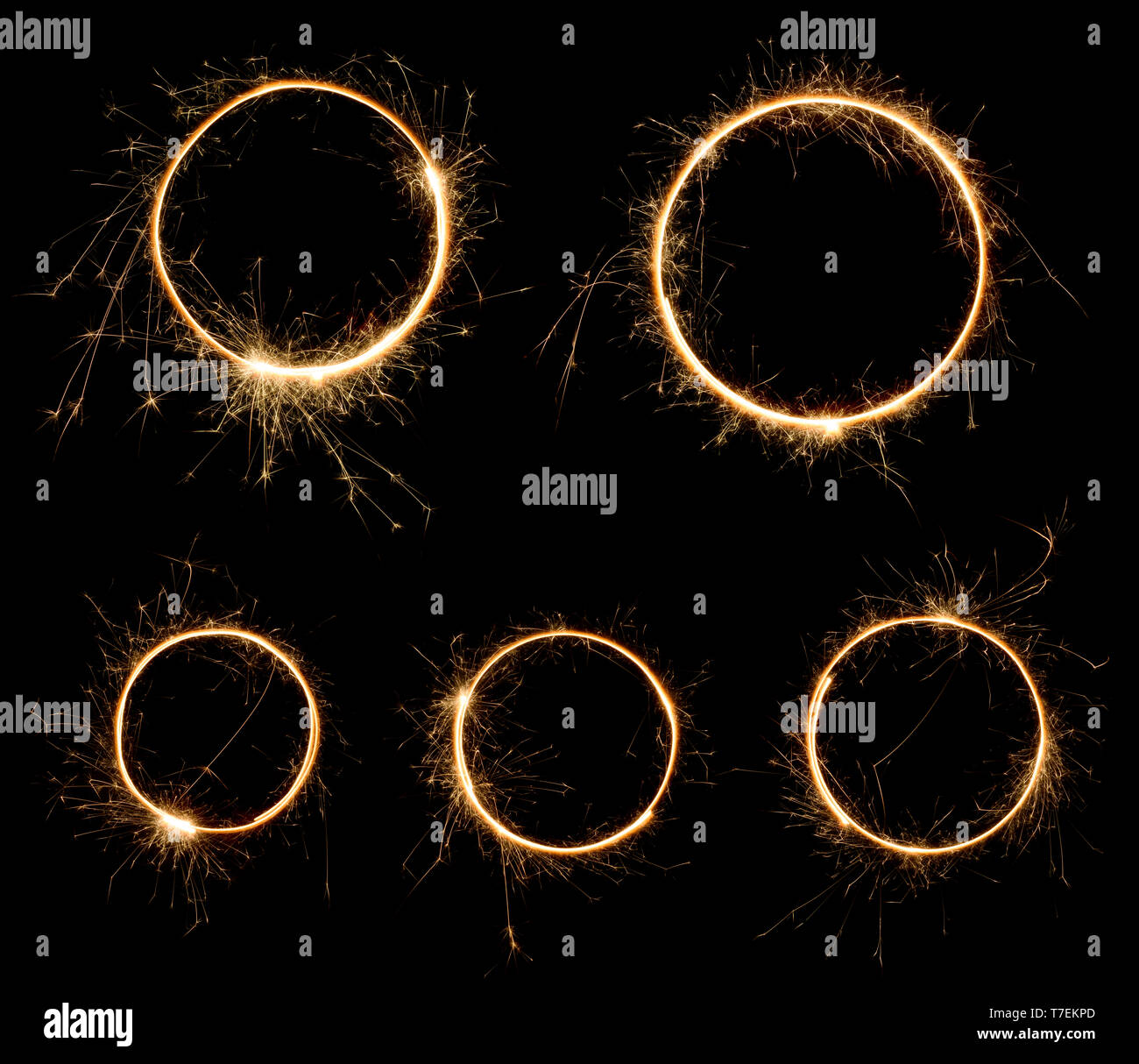 Sparklers rings isolated on black. Set of burning bengal fire long exposure circles. - Stock Image