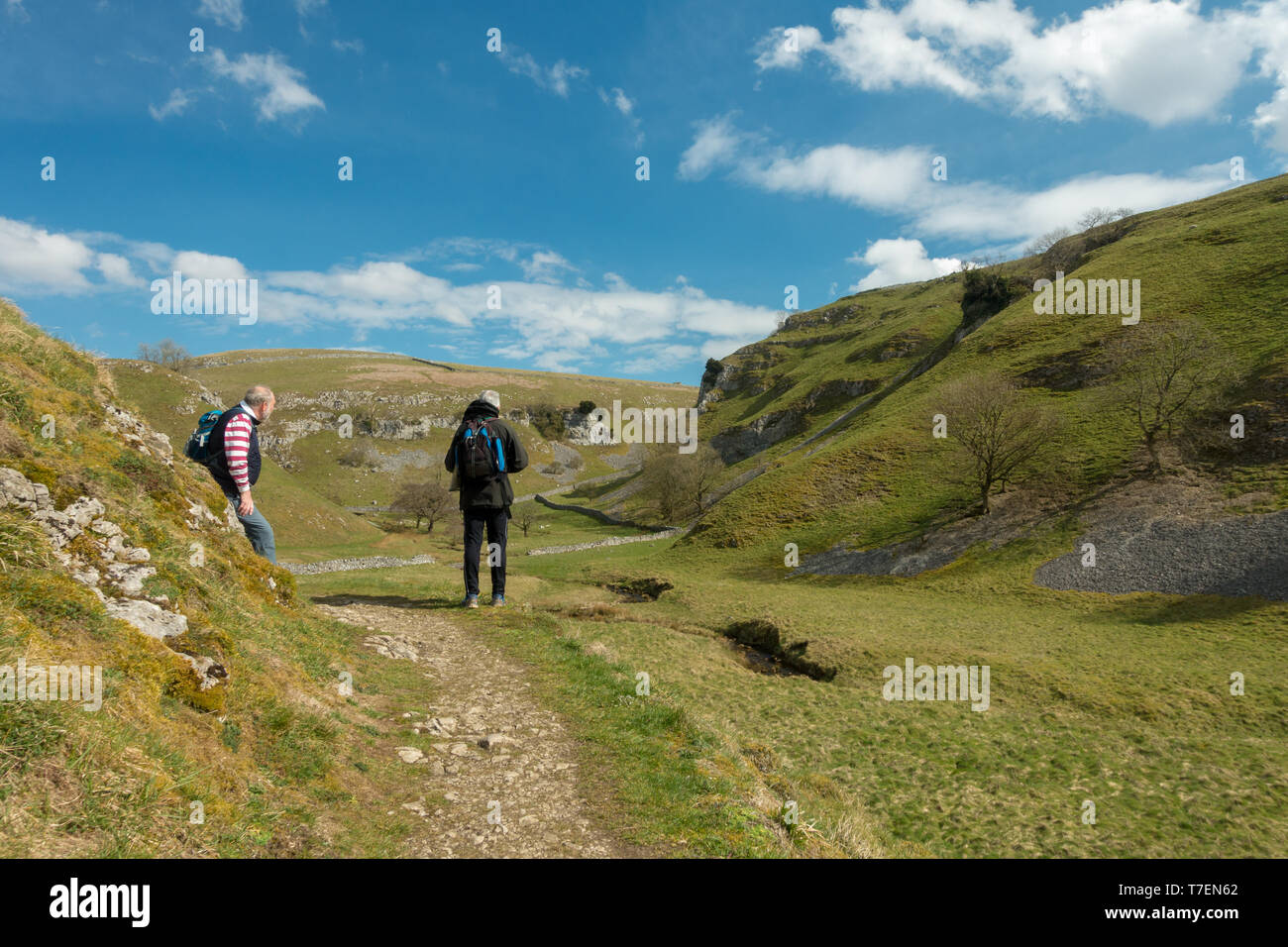 Men socialising: Seniors enjoying views over Trollerdale from the path to Troller's Gill near Appletreewick, Yorkshire Dales - Stock Image