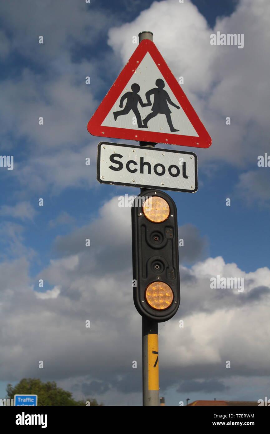 Road sign near British school crossing sign - Stock Image