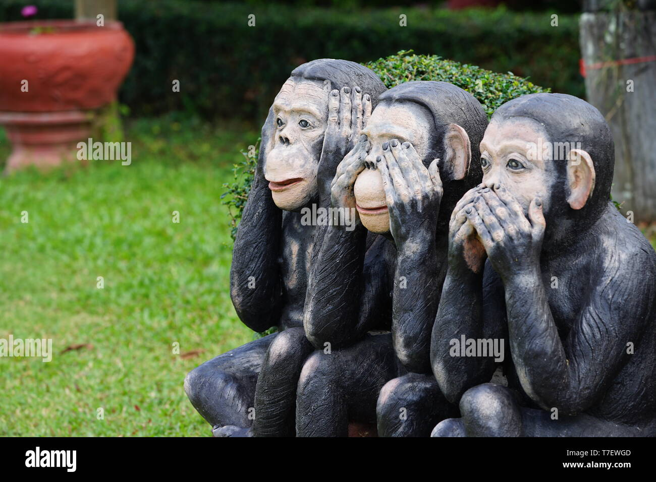 three black monkeys statue siting on the rock in the row; close eyes, close mouth, close ear., Thailand - Stock Image