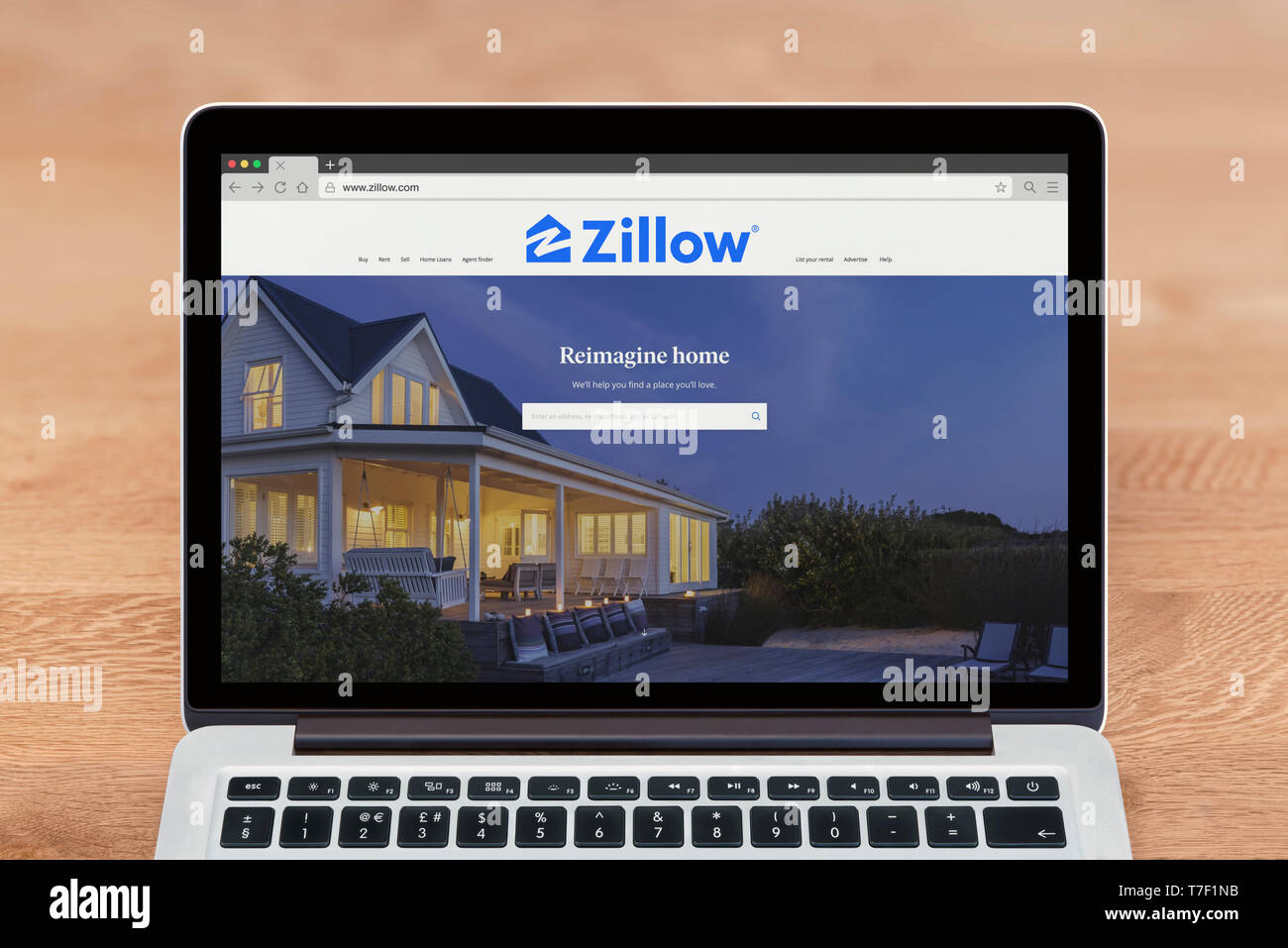An Apple Macbook displays the Zillow website (Editorial use only). - Stock Image