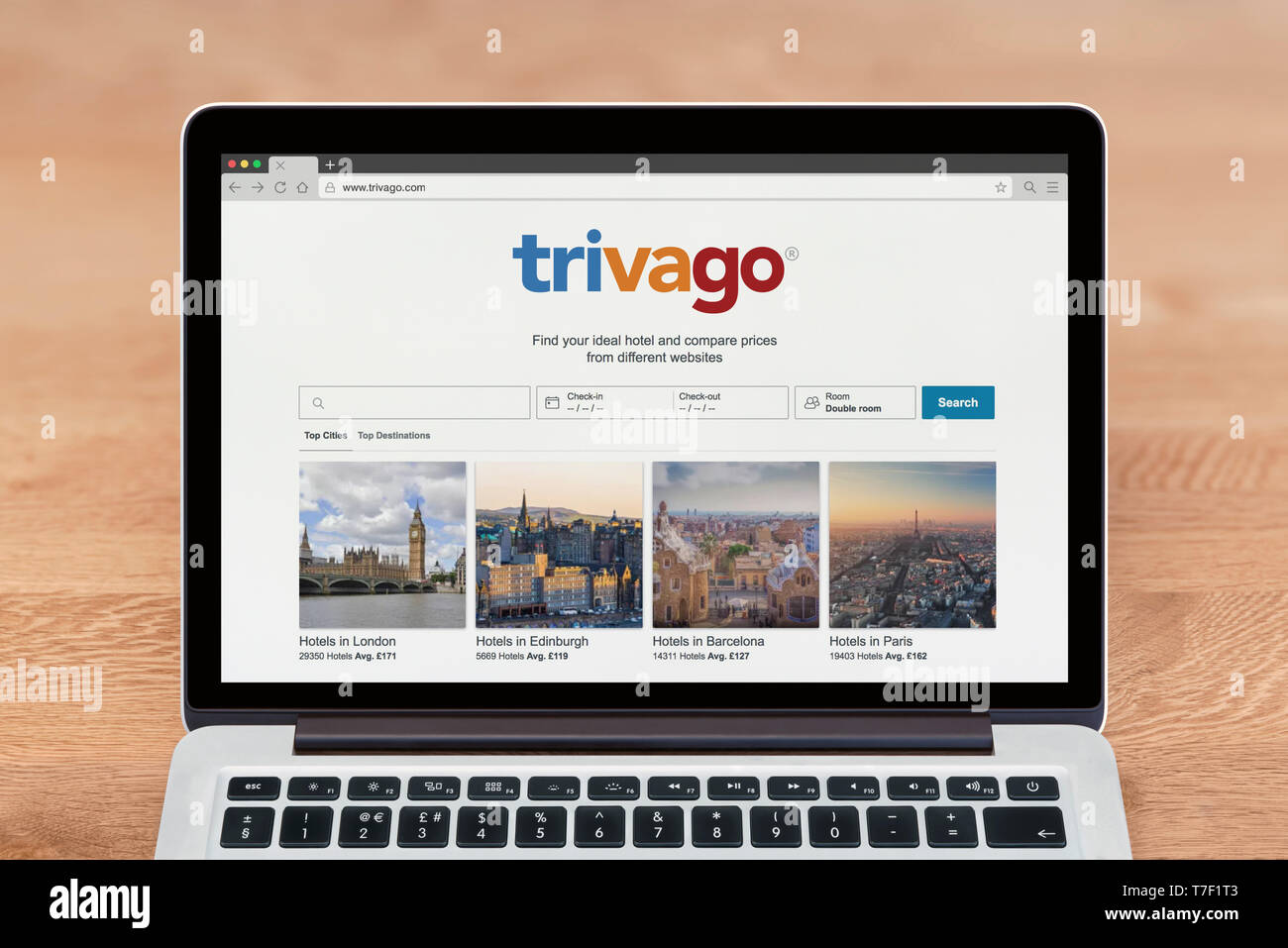 An Apple Macbook displays the Trivago website (Editorial use only). - Stock Image