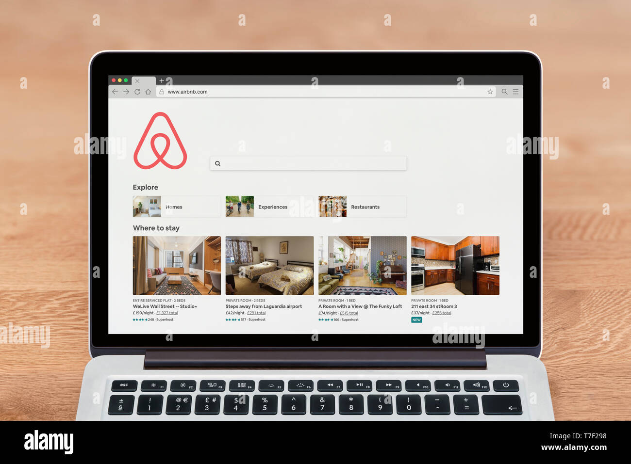 An Apple Macbook displays the Airbnb website (Editorial use only). - Stock Image