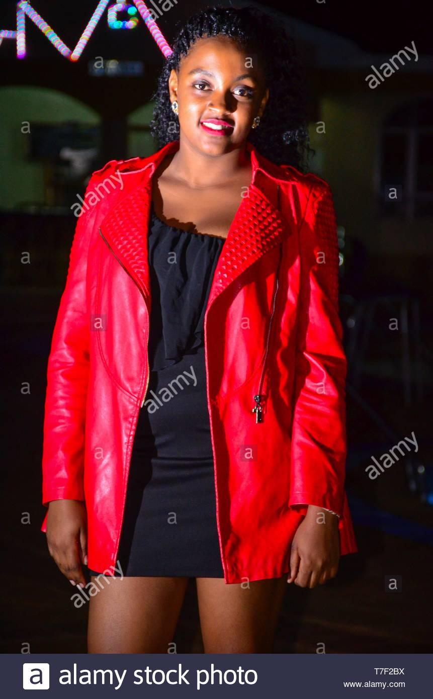 GIRL WEARS RED JACKET Stock Photo