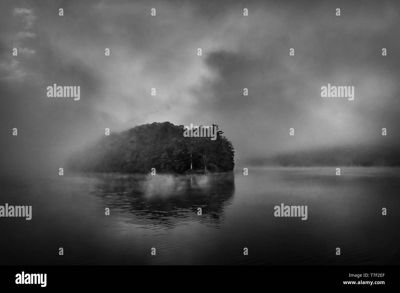 Misty Foggy Mountain Lake - Stock Image