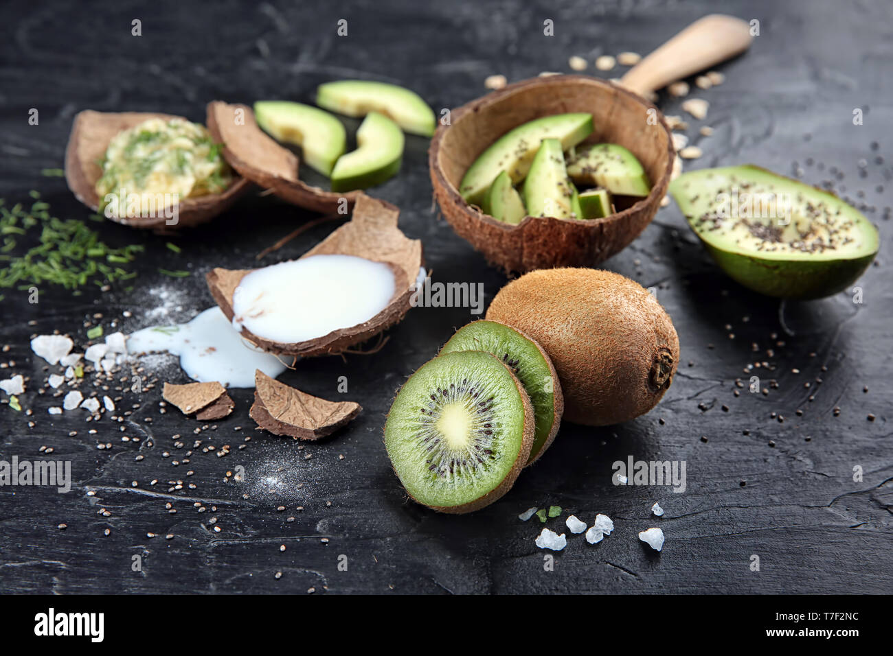 Natural ingredients for homemade cosmetics on black textured