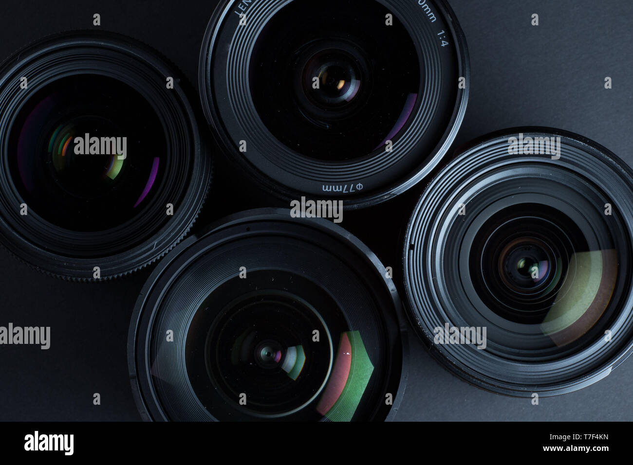 Set of various DSLR lenses with colorful reflections - Stock Image