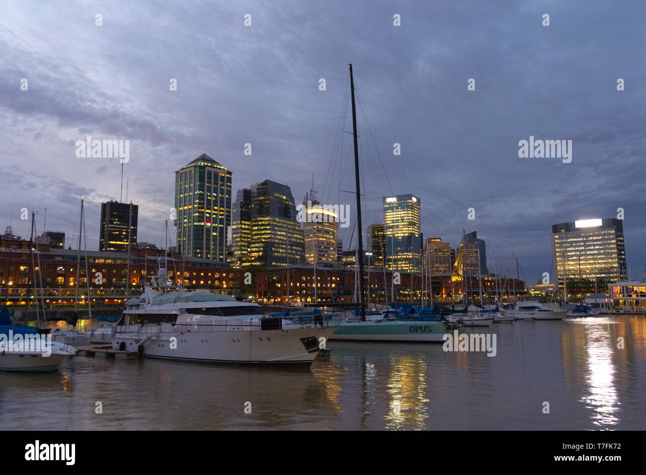 Several yachts anchored in Puerto Madero, Buenos Aires, at dusk. - Stock Image