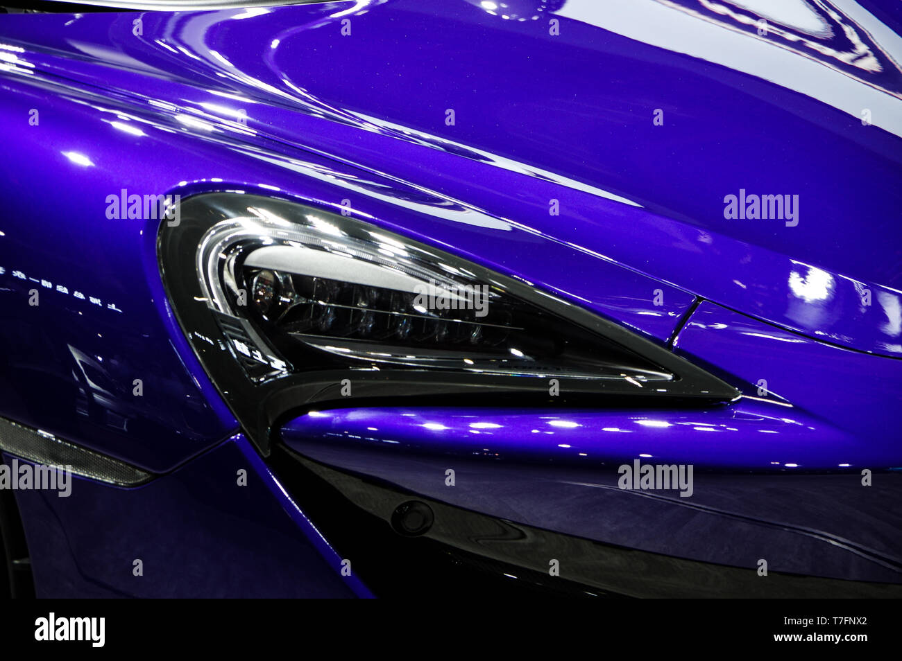 Modern purple car headlight details Stock Photo