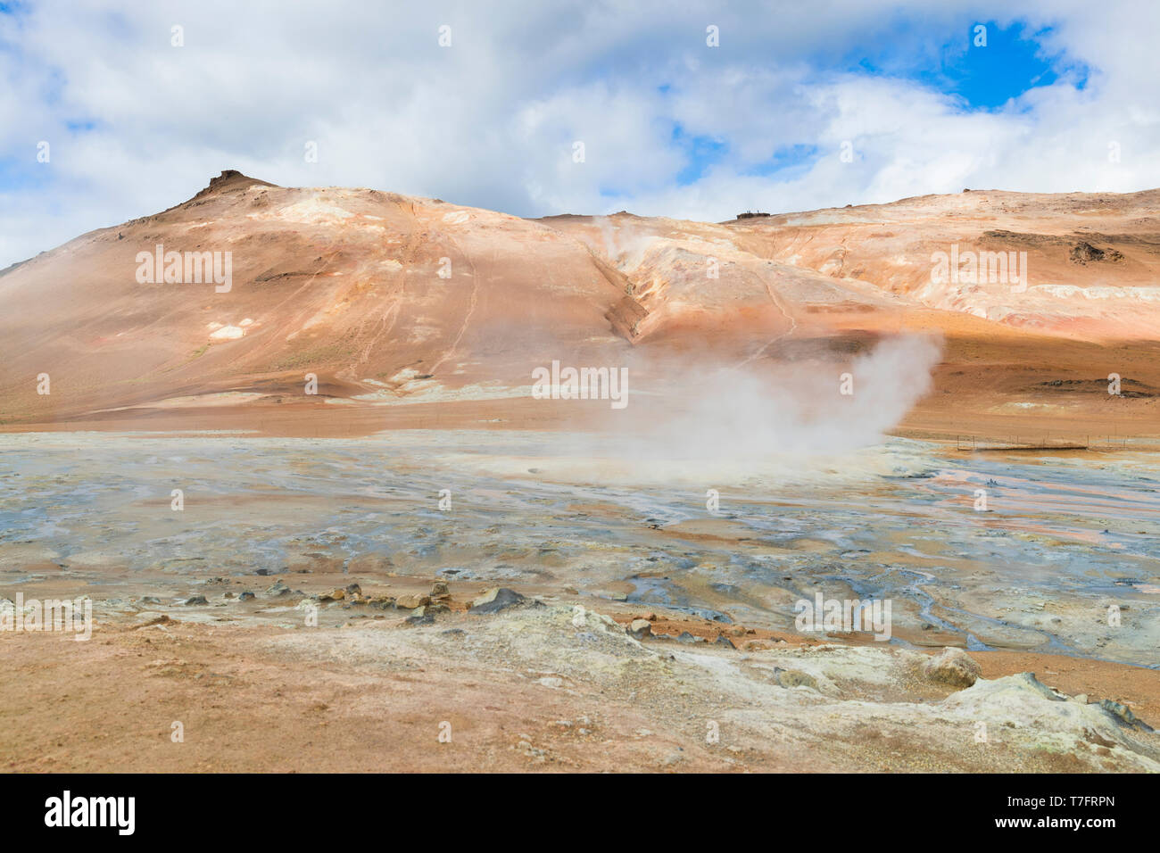 Landscape at Hverir, red sulphurous soil with fumaroles Stock Photo