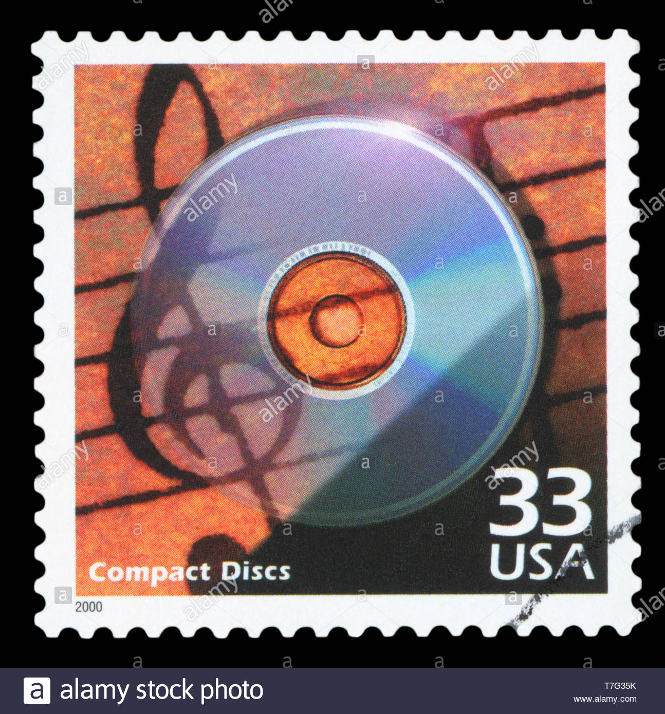 UNITED STATES OF AMERICA, CIRCA 2000: a postage stamp printed in USA showing an image of a compact disc, circa 2000. - Stock Image