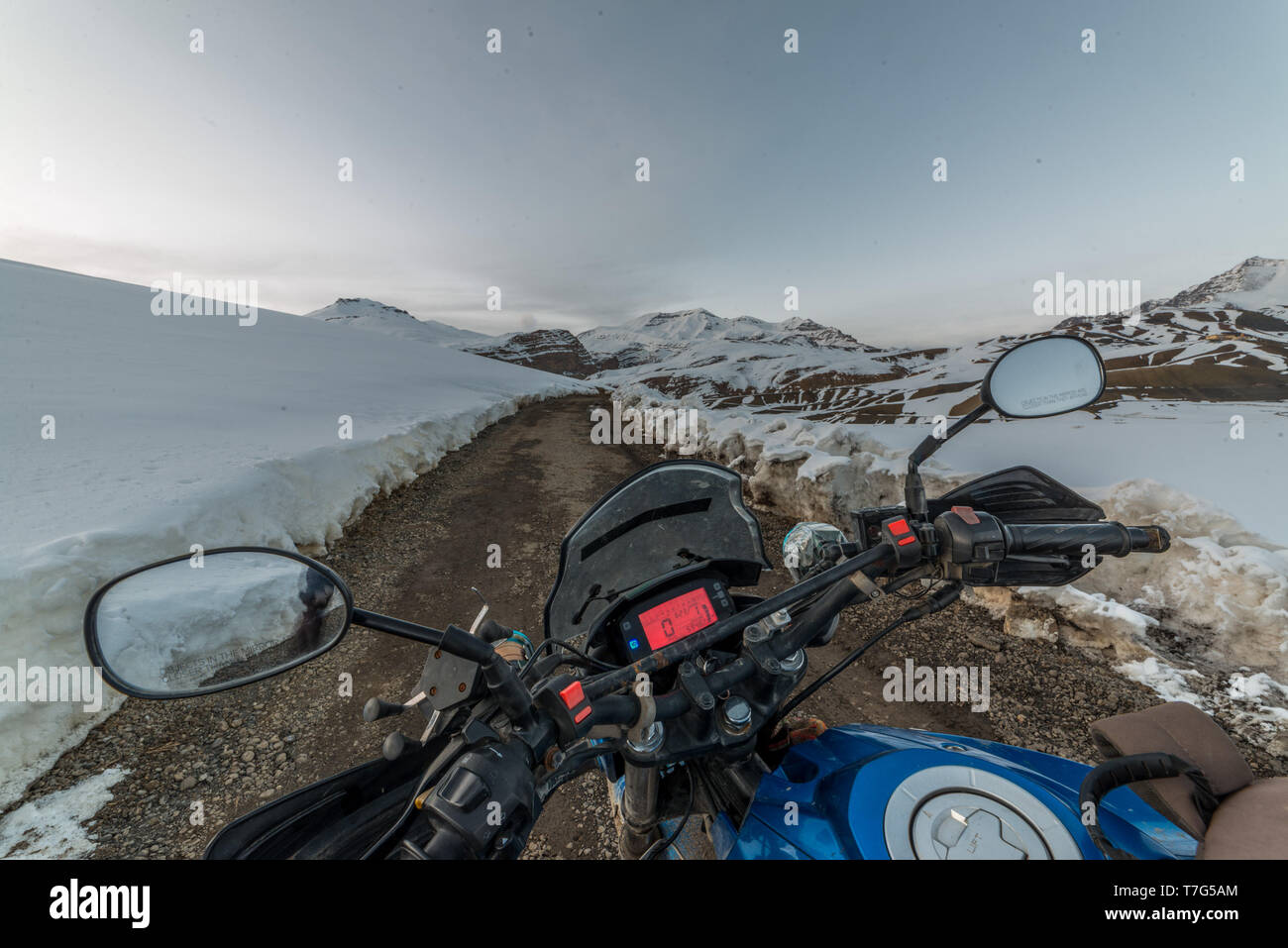 Spiti, Himachal Pradesh, India - March 26, 2019 : Biker at open road in winter in himalayas of india - Stock Image