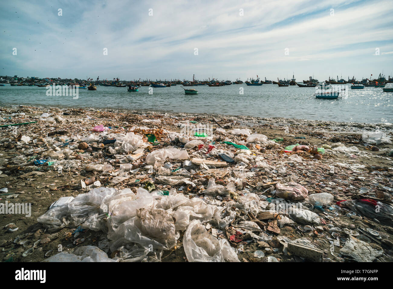 Garbage and basket boats on the beach. Bad environmental situation near the sea in Vietnam. MUI ne. Fishing village. - Stock Image