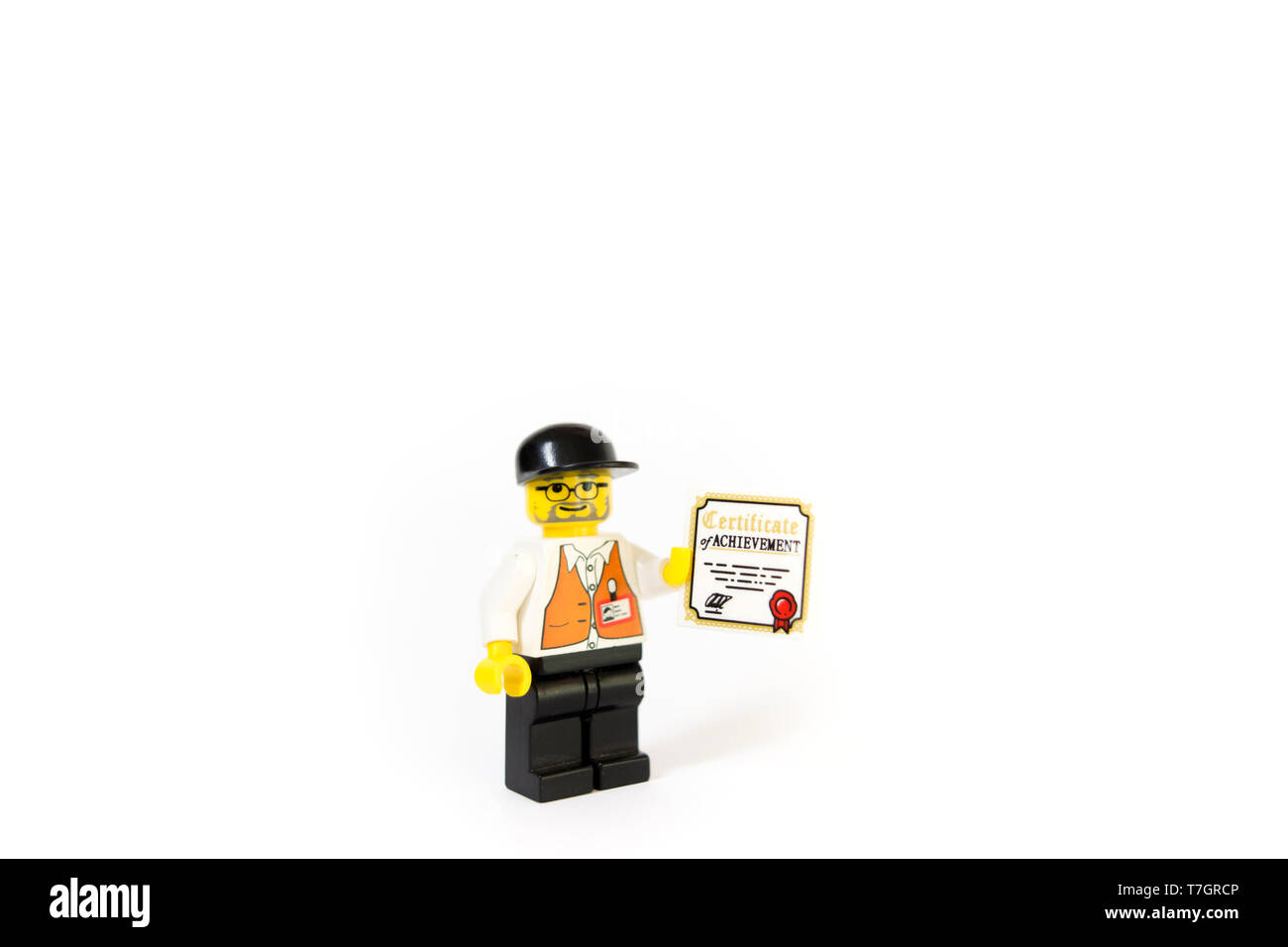 This photo of a LEGO Film Director progressing his career with his certificate of achievement. Movie Director career progression. - Stock Image