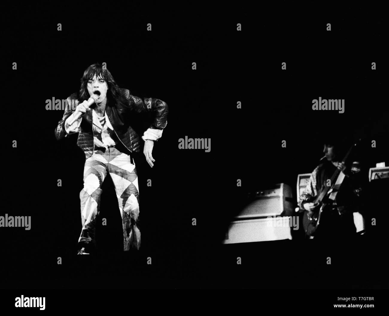 FRANKFURT, GERMANY: Mick Jagger from The Rolling Stones perform live on stage at the Festhalle in Frankfurt, Germany on April 28 1976 as part of their European tour (Photo by Gijsbert Hanekroot) Stock Photo