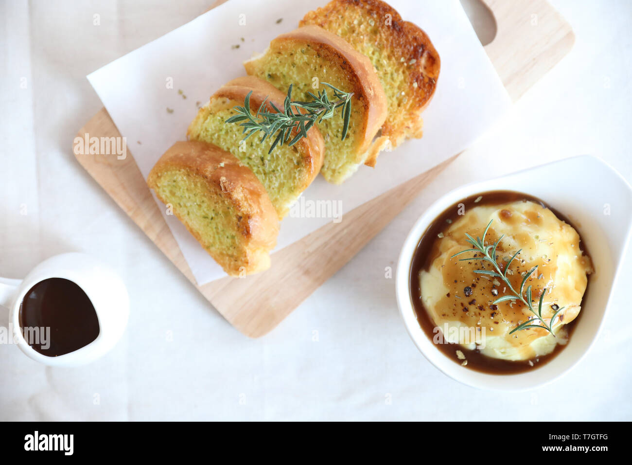 Mashed potato with gravy and bread - Stock Image