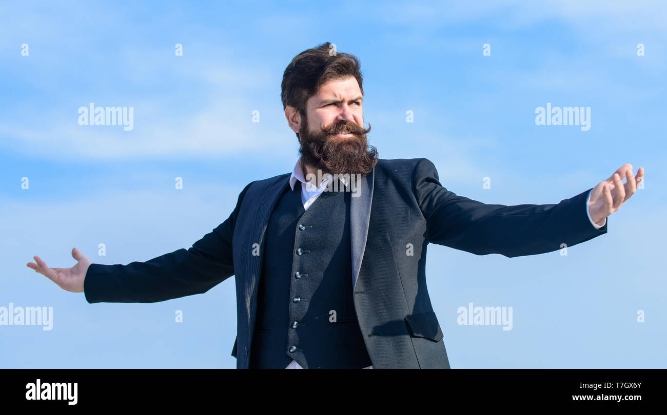 Man bearded proud himself sky background. Superiority and power. Feeling undefeated. Proud of himself. Self proud and narcissistic. Hipster bearded attractive enjoy freedom. Guy enjoy top achievement. - Stock Image
