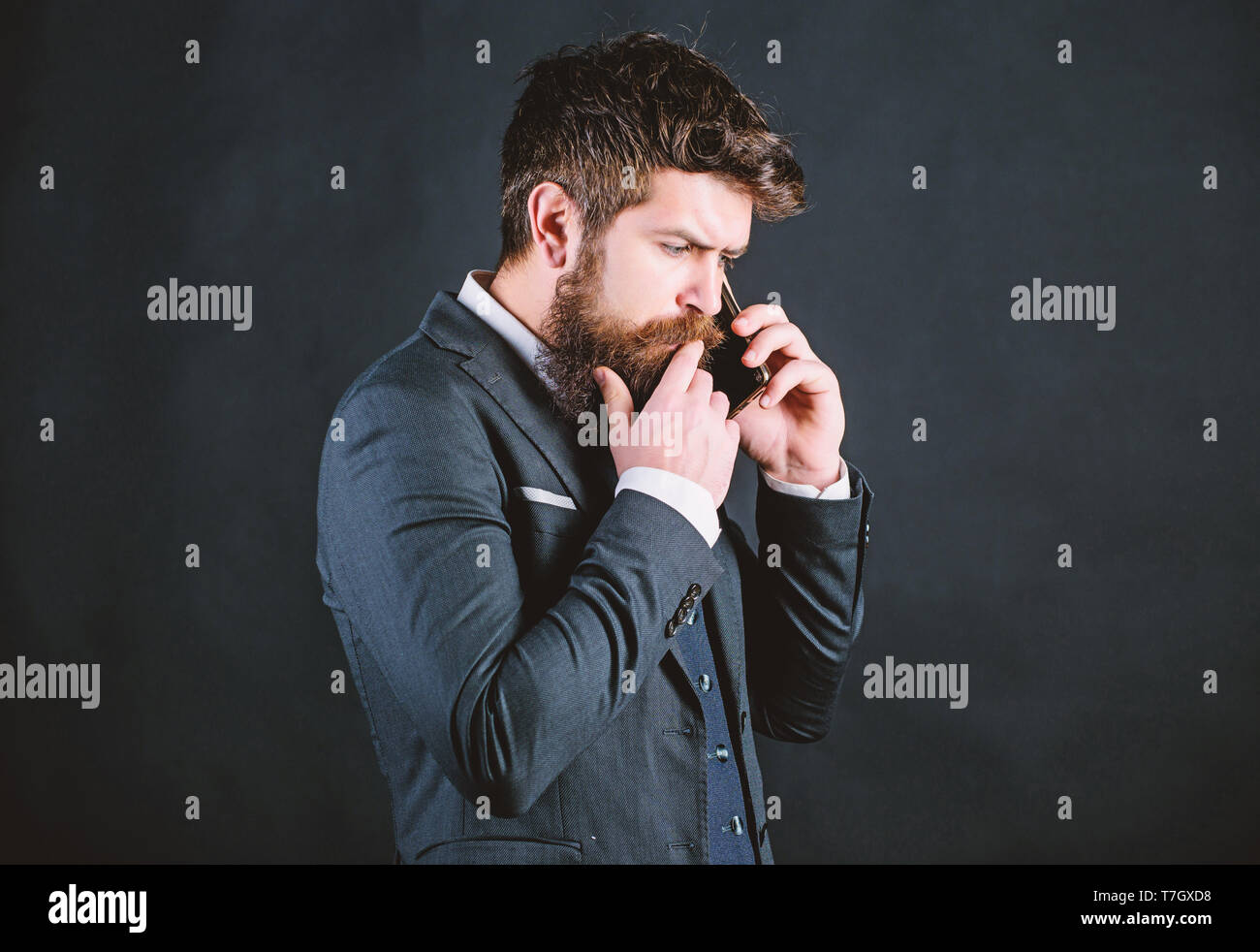 Mobile call concept. Mobile call conversation. Mobile negotiations. Businessman well groomed mature man hold smartphone. Guy call friend stand black background. Man formal suit call someone. - Stock Image