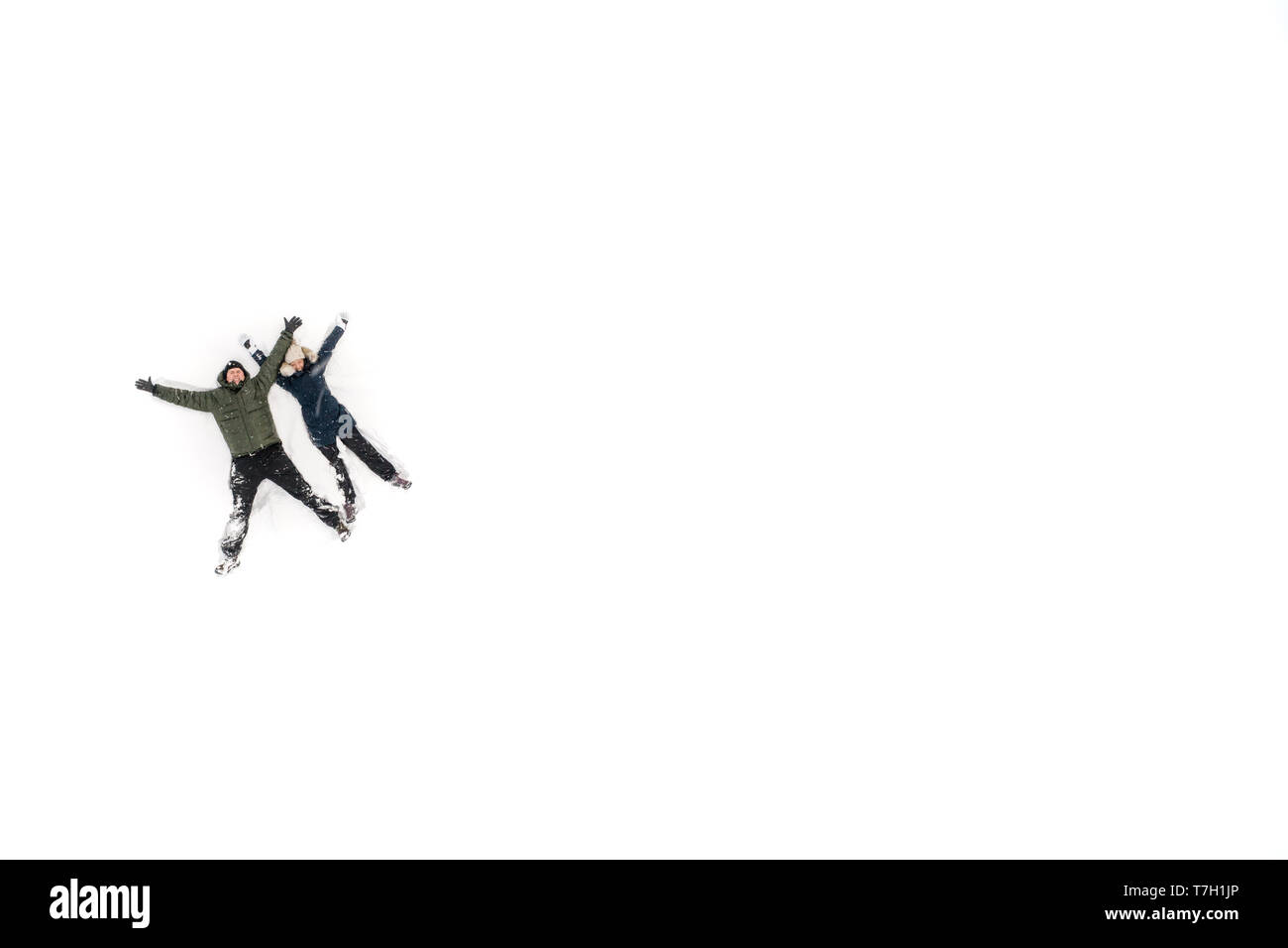 Aerial image of a happy couple having fun on white now Stock Photo