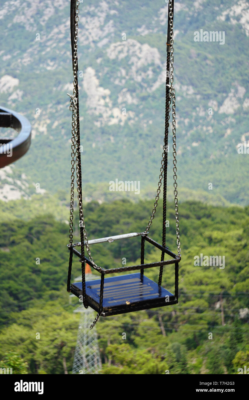 Swinging by the cliff of the mountain - Stock Image