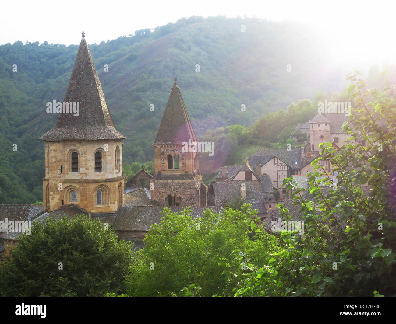 Conques, historic town along the Via Podiensis, also know as Le Puy Route, in southern France. Next to Abbey-Church of Saint-Foy. - Stock Image