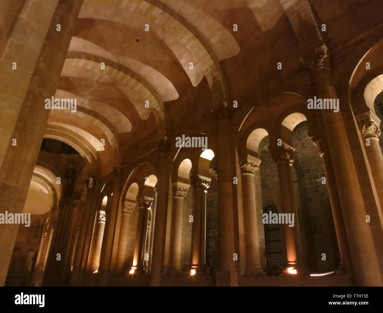 Inside Abbey-Church of Saint-Foy in Conques during the night. A historic town along the Via Podiensis in southern France. - Stock Image