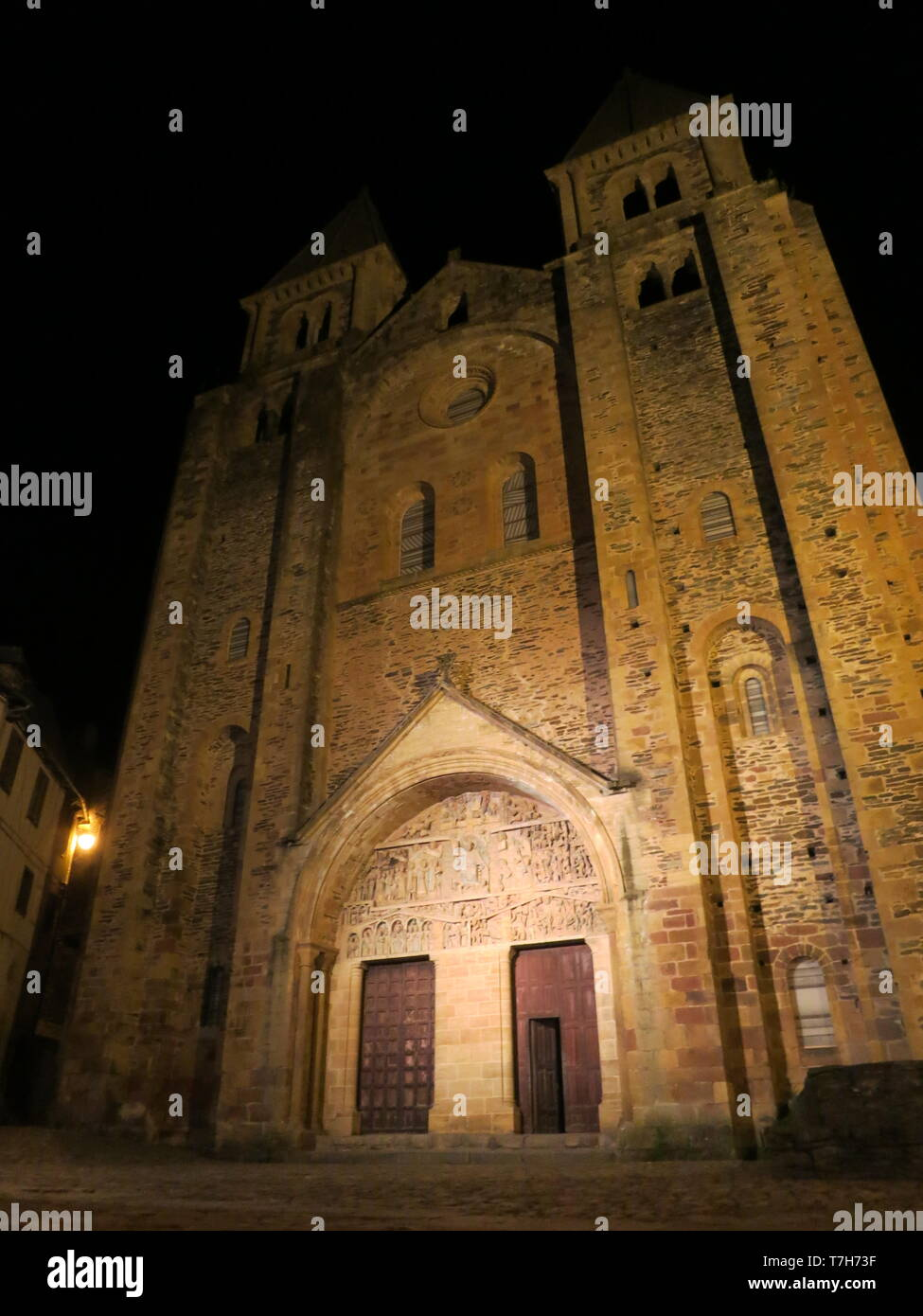 Abbey-Church of Saint-Foy in Conques during the night. A historic town along the Via Podiensis in southern France. - Stock Image