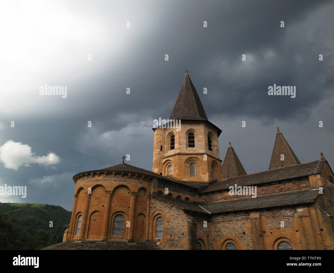 Conques, historic town along the Via Podiensis, also know as Le Puy Route, in southern France. Next to Abbey-Church of Saint-Foy.. - Stock Image