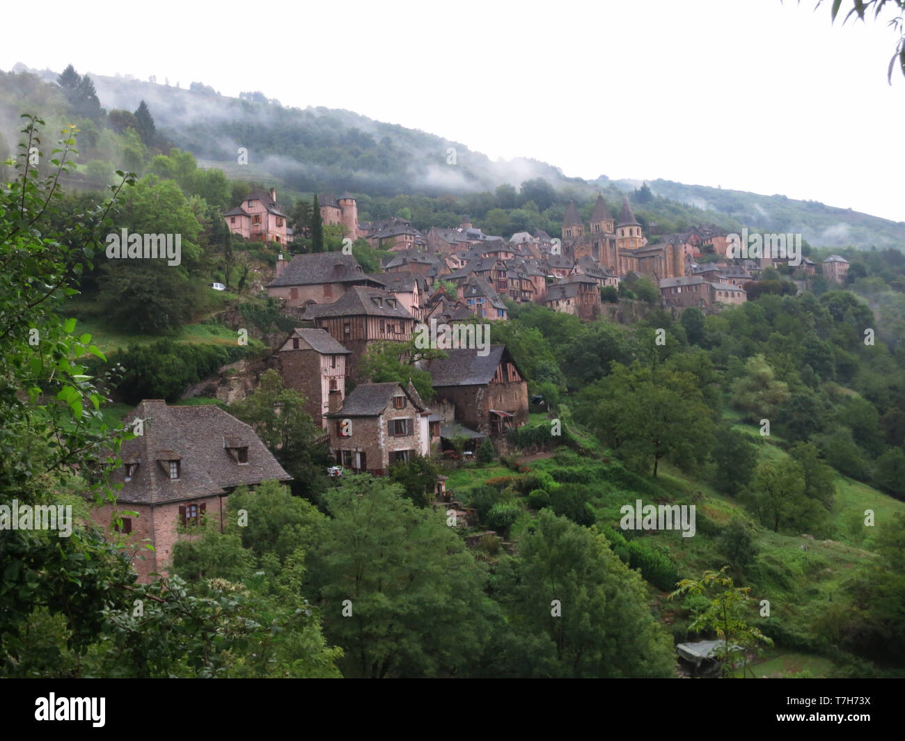 Conques, historic town along the Via Podiensis, also know as Le Puy Route, in southern France. - Stock Image