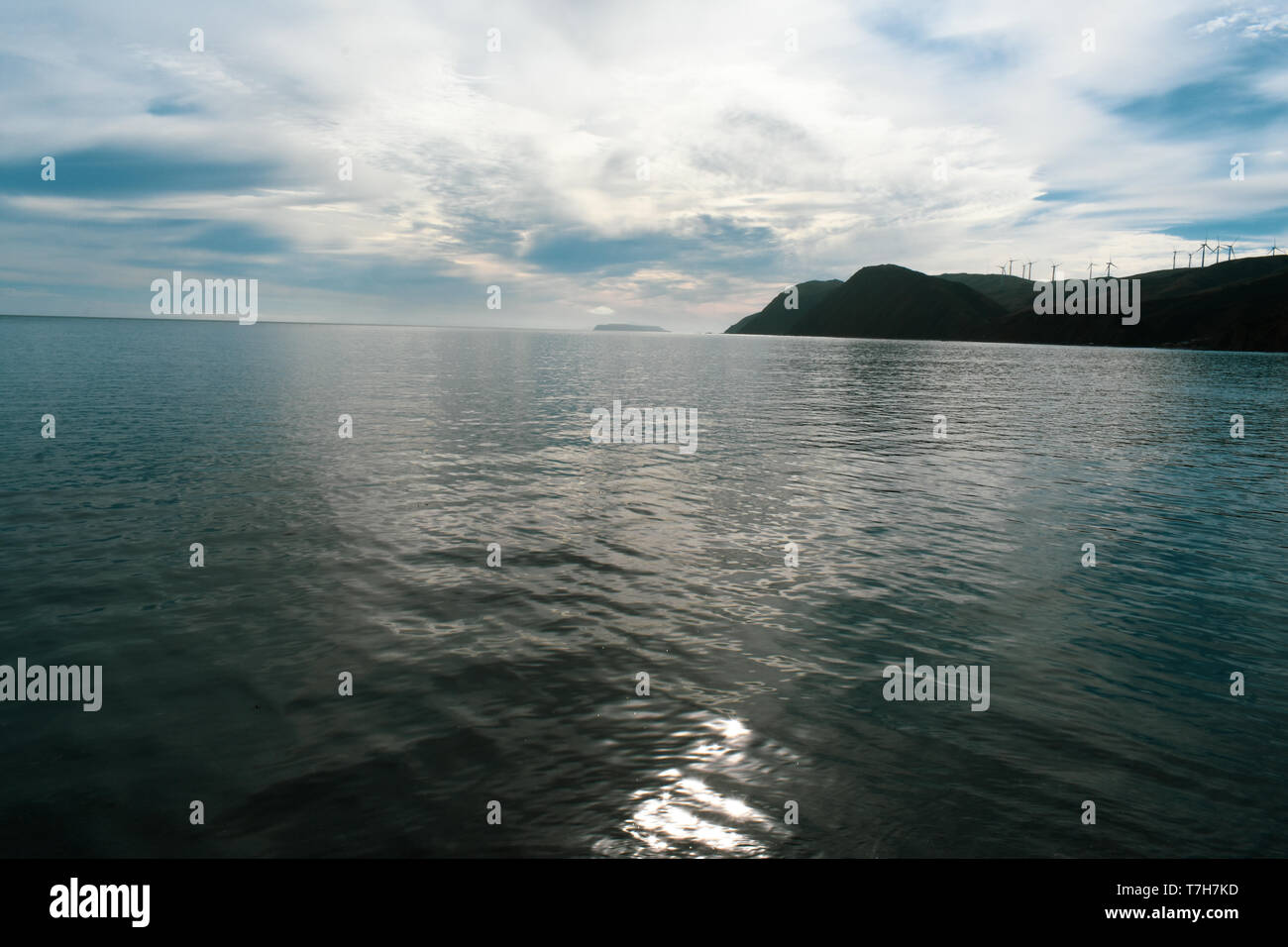 A beautiful flat ocean with a stunning sky Stock Photo