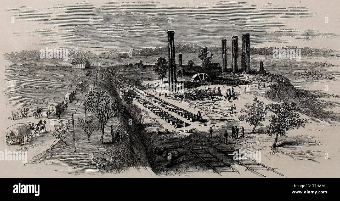 Sherman's Campaign - Ruins of Cars and rolling mill destroyed by the Rebels in Atlanta, Georgia, 1864 - American Civil War Stock Photo