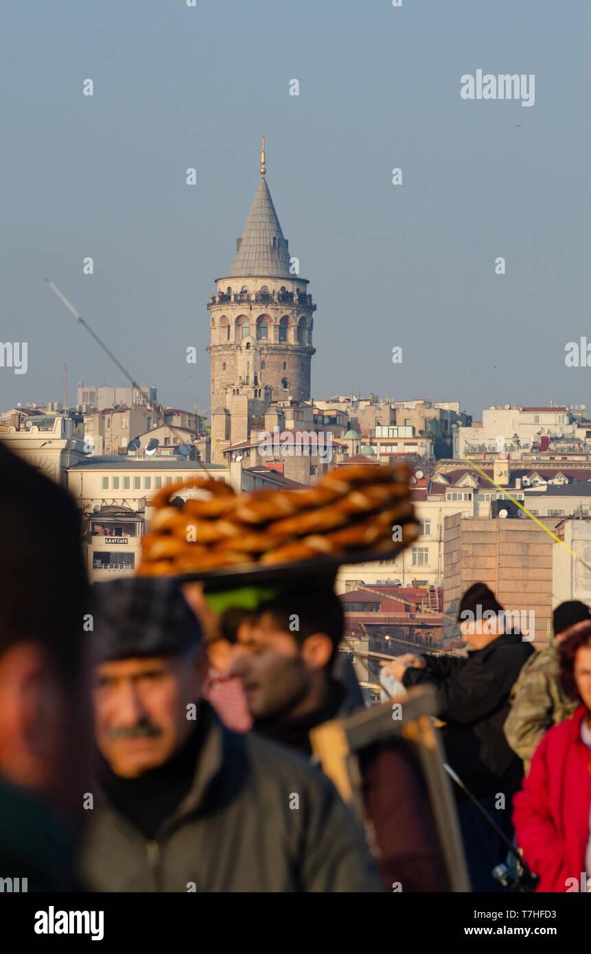 busy Istanbul street including vendors selling Simit, the Galata Bridge, Istanbul, Turkey Stock Photo