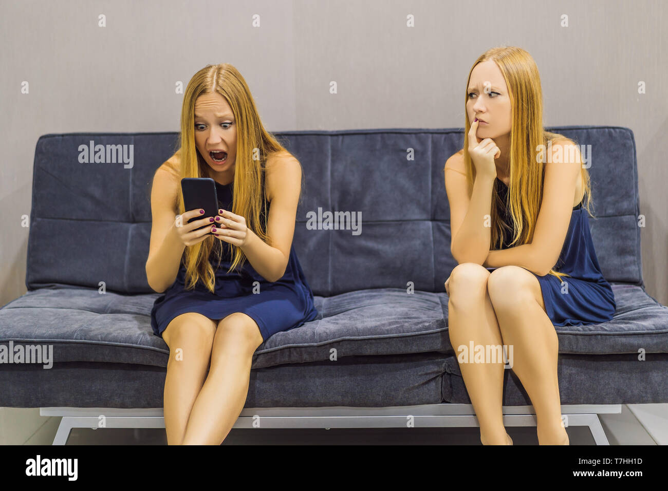Woman experiencing sad emotions using a smartphone and evaluate their emotions from the side. Emotional Intelligence Concept - Stock Image