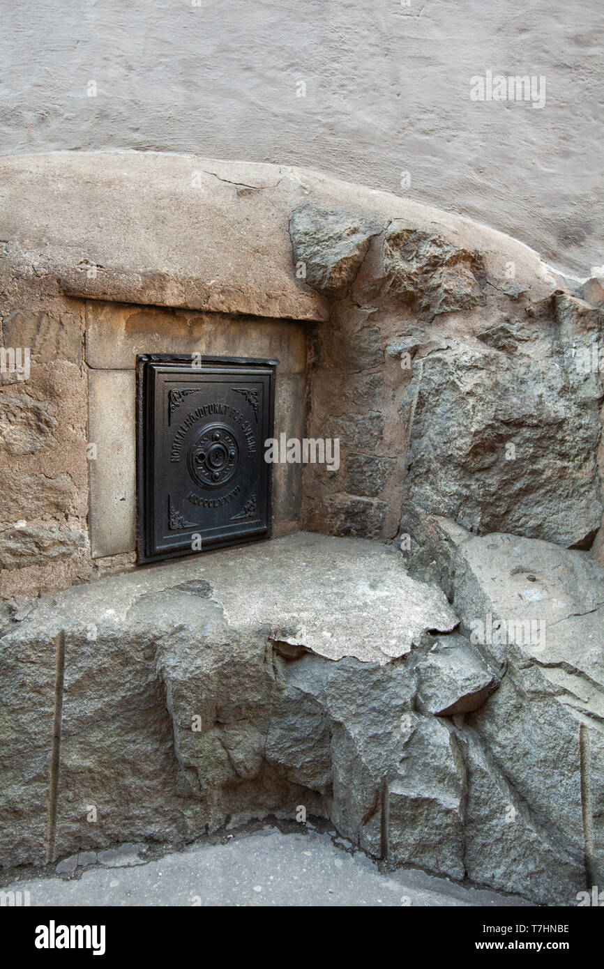 Stockholm's official ordnance datum sits behind this locked door. - Stock Image
