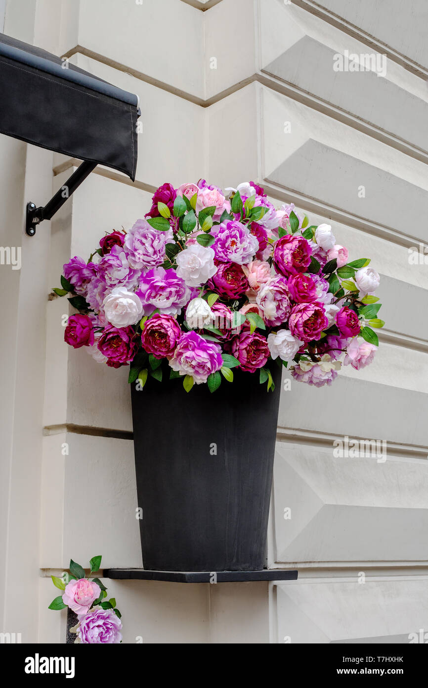 Artificial Peony In Black Vase On House Facade Colorful Bouquet Of Paeony Flowers On Wall Floral Composition Stock Photo Alamy