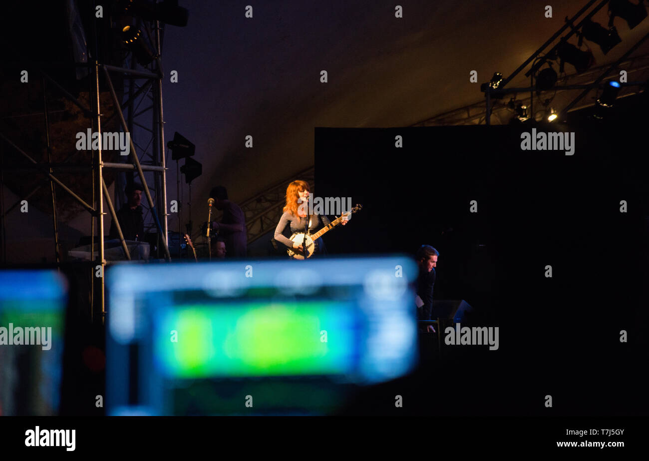 Singer songwriter Lisa LeBlanc performs at the Regina Folk Festival in Saskatchewan, Canada, viewed from behind the sound board at the main stage - Stock Image