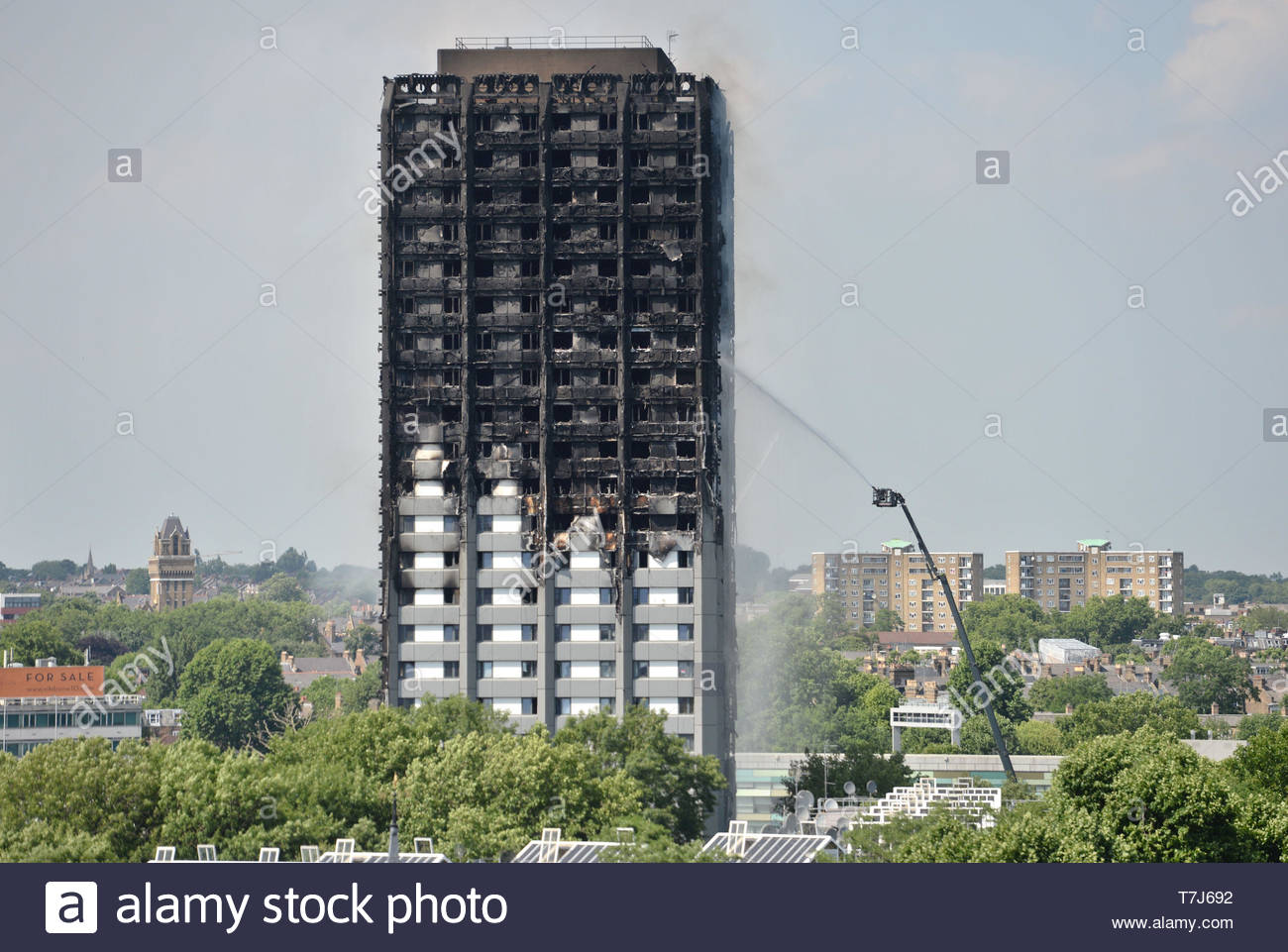 Embargoed to 0001 Wednesday May 08 File photo dated 14/06/17 of firefighters spraying water after the fire engulfed Grenfell Tower in west London. Grenfell families have hit out at the 'amnesia fix' of corporations during the public inquiry, and called the delay in bringing in urgent fire safety recommendations a farce. - Stock Image