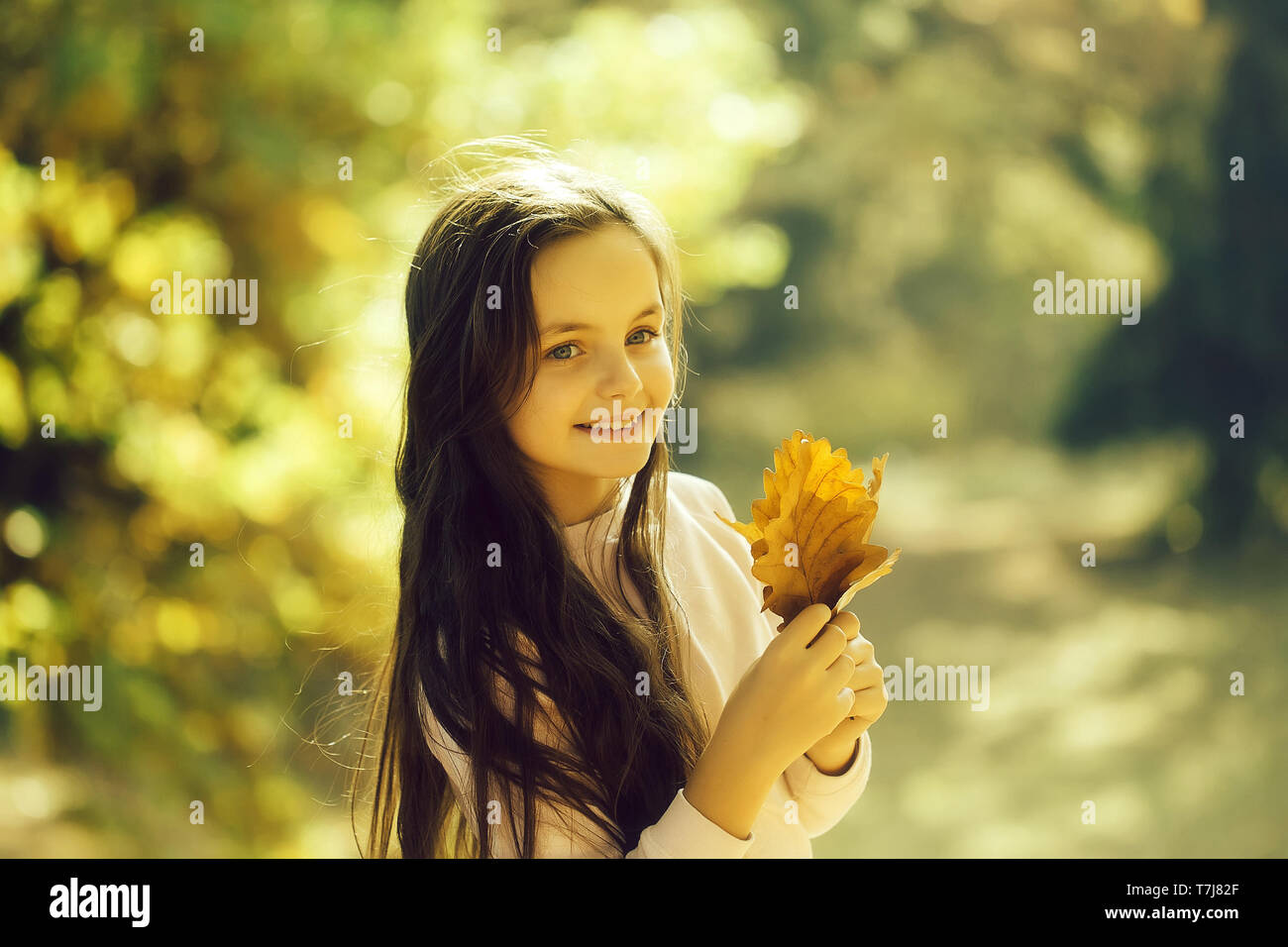 Cute school age girl - Stock Image