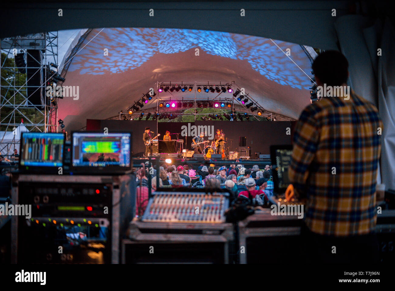 View of the main stage from behind the during the Vancouver Folk Festival at Jericho Beach Park, in British Columbia, Canada - Stock Image