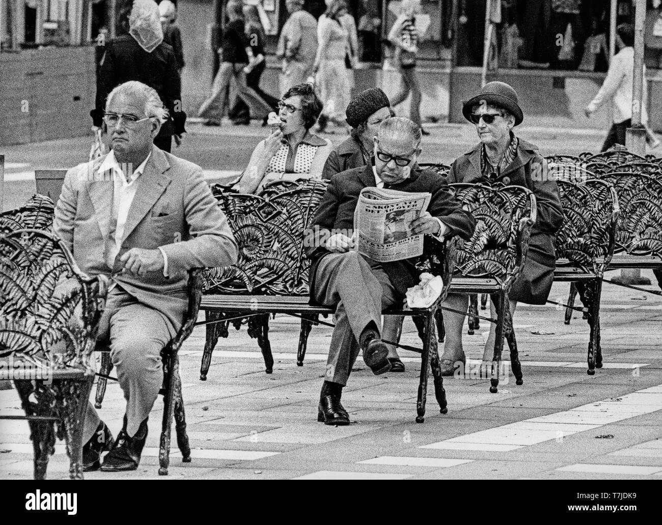 people on benches, stockholm, sweden, 70s - Stock Image