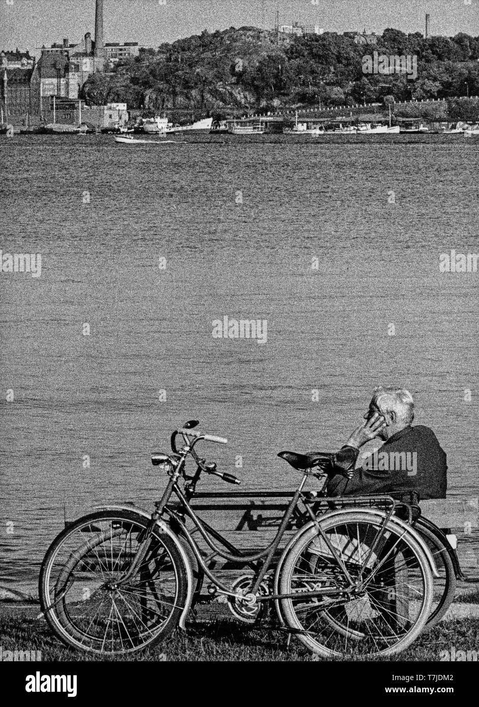 old man on the bench, stockholm, sweden, 70s - Stock Image