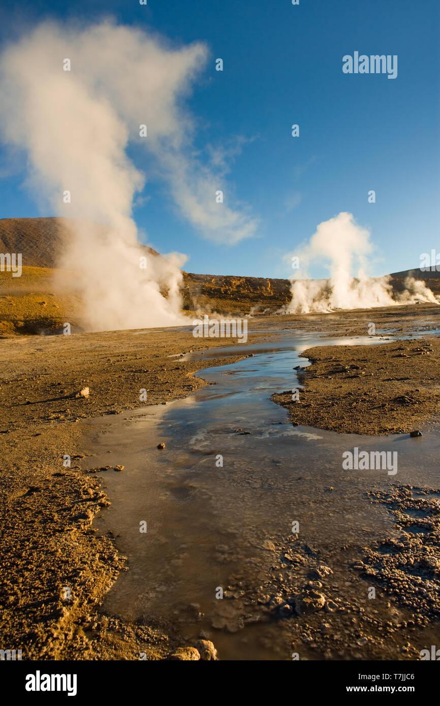 Frozen water and fumaroles at an altitude of 4300m, El Tatio Geysers, Atacama desert, Antofagasta Region, Chile, South America - Stock Image