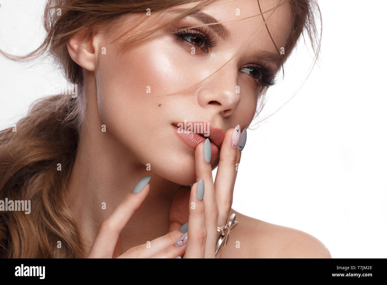 Pretty Girl With Easy Hairstyle Classic Makeup Nude Lips And Manicure Design With Jar Of Nail Polish In Her Hands Beauty Face Art Nails Stock Photo Alamy
